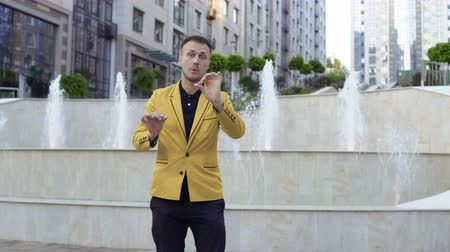 büyücü : Illusionist showing focus with red shawl at the fountain background