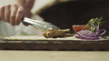 pita : Cook puts rib on piece of pita bread on stand Stock Footage