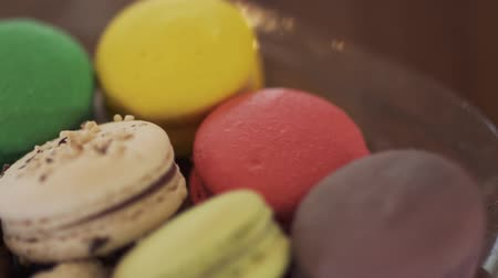 cutted : Colorful macaroons at plate, camera in motion