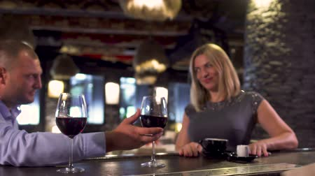 embarrassed : Man orders wine for beautiful lady in restaurant