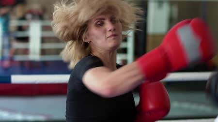 хит : Woman in boxing gloves training with coach