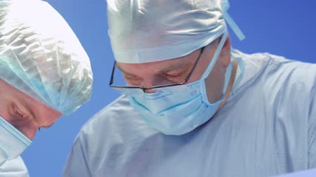 paramedics : Two professional surgeons during operation