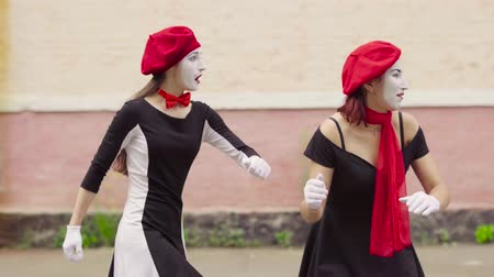 gesticulando : Funny dressed mimes make perfomance near building