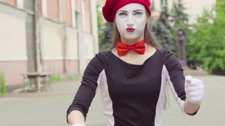 invisible : Mime girl imitates driving car Stock Footage
