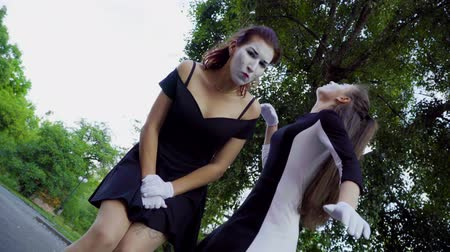 greasepaint : Two funny mimes girls imitate flirt on camera