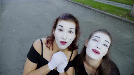 greasepaint : Two girls mimes imitate embarrassment when see camera Stock Footage