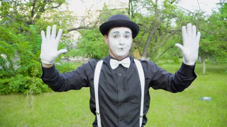 greasepaint : Funny mime is crooking on camera in the park