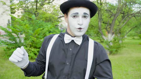 greasepaint : Comic mime is crooking on camera in the park