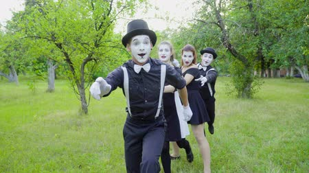greasepaint : Mimes froze holding each other Stock Footage