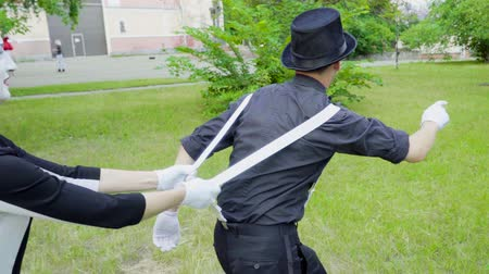 greasepaint : Funny mimes froze holding each other