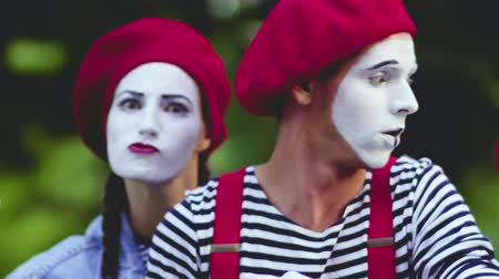 greasepaint : Mimes look with imitation of anger trying to scare viewer