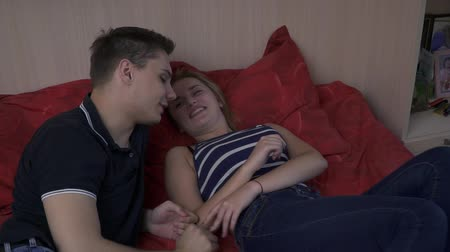 kin : Young couple in bed in the bedroom have fun