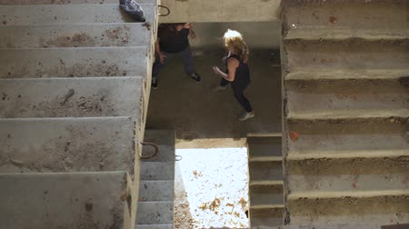 uncomfortable : Fight of two girls in the stairwell Stock Footage