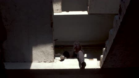 desgrenhado : Blond girl is smoking in an abandoned building Stock Footage
