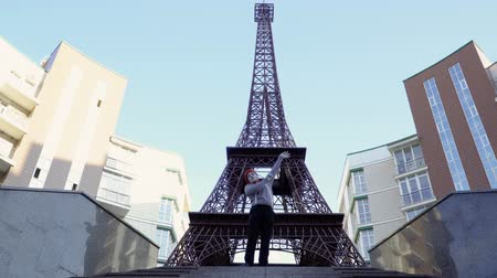 eiffel : Comedian mime fooling around near Eiffel tower Stock Footage
