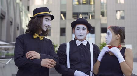 fool : Three funny mimes have fun with each other in front of camera
