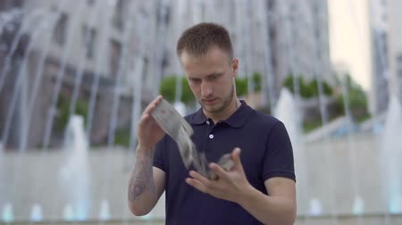 büyücü : Handsome man with playing cards at fountain background Stok Video