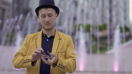büyücü : Magician in yellow jacket with playing cards in hands