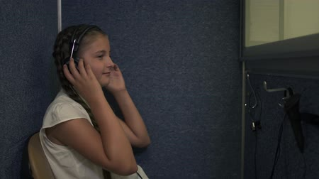 listens : Little girl undergoes a hearing test
