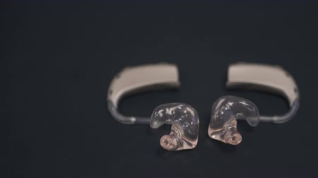 cancellation : Two hearing aids on the table are lined in the form of a heart