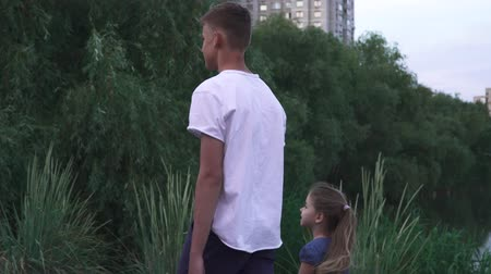 tölt : Brother and sister are walking near the river together