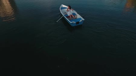 вокруг : Young girl boating on the lake