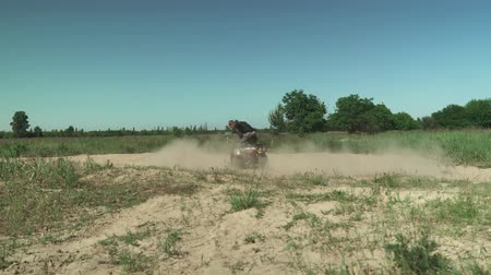 quadbike : Young man drives ATV in circles Stock Footage