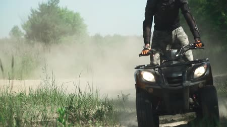 quadbike : Young man drives ATV fast Stock Footage