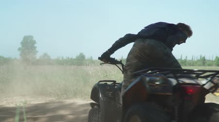 quadbike : Teenager rides ATV in the field