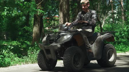 jump away : Blond teenager jumps at ATV and drives away