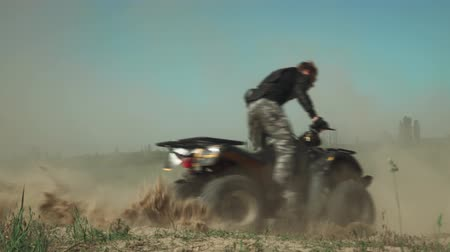 quadbike : Young adrenaline lover drives ATV in circles