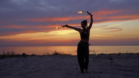 kmenový : Wild looking lady is dancing on the sunset