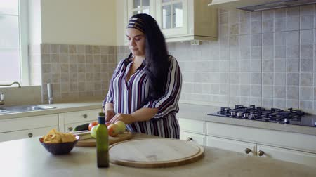 paunchy : Plump girl is cooking in the kitchen