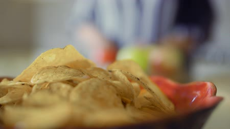 paunchy : Plate with chips in the foreground Stock Footage