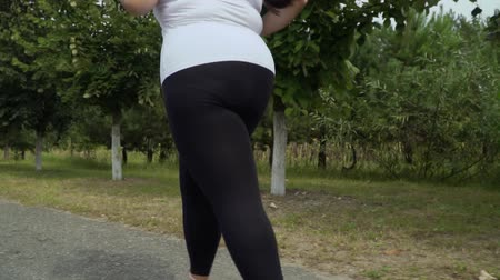 paunchy : Fat girl runs along the road