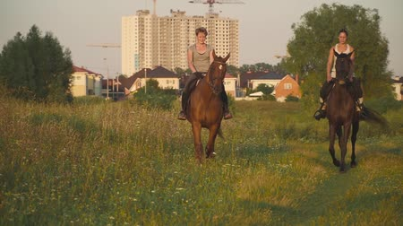 jezdecký : Two girls ride horses