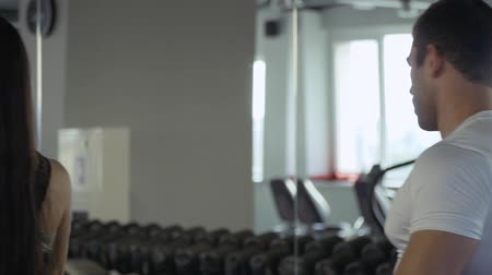 treadmill : Beautiful girl in a gym Stock Footage