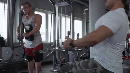 treadmill : Two young guys in the gym Stock Footage