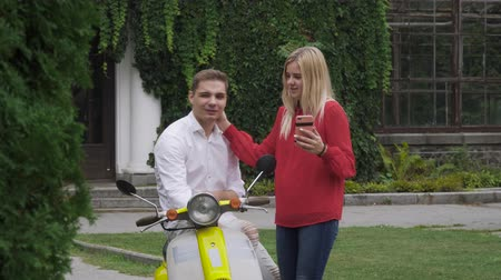 skútr : Young couple makes a selfie near the motorbike Dostupné videozáznamy