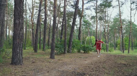 atirador : Girl in red dress with bow running cross forest