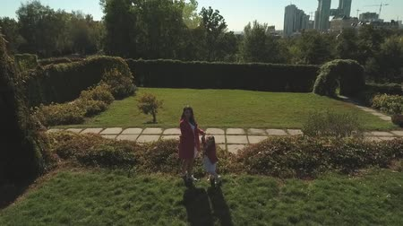 benzer : Mom and daughter in the park together. Shot on drone