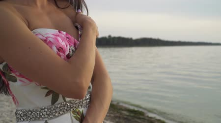 seductive : Romantic woman in evening dress by the river Stock Footage