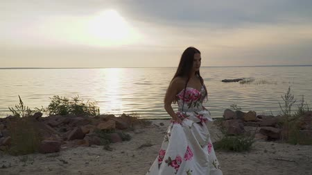 darling : Beautiful girl in a long beautiful dress walks along the river bank