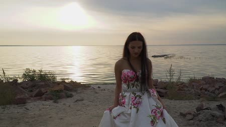 darling : Charming girl in evening dress by the river
