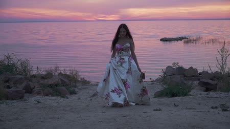 liberal : Charming lady in a long dress on a beautiful beach