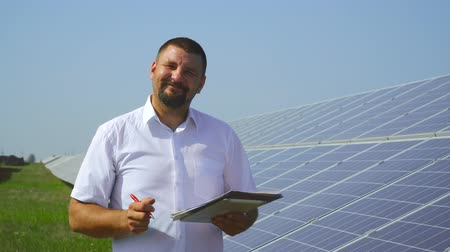 enviroment : Male holding records of solar panels