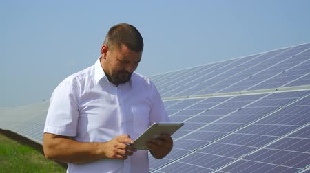 sustainable resources : Man holding records of solar panels