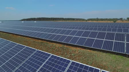 enviroment : Long plate with a solar panels on meadow. Shot on drone Stock Footage