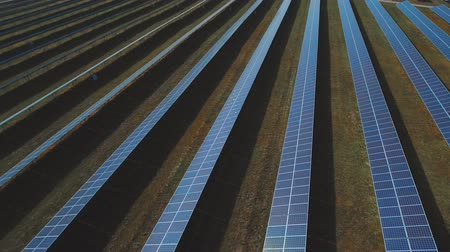 enviroment : Plant of blue solar panels. Shot on drone