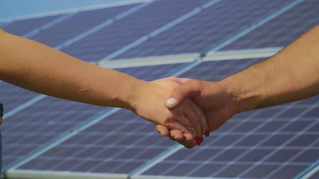 enviroment : Male and female hands shake each other Stock Footage